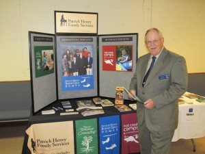 Pastor Guy Stockslager with Patrick Henry Homes literature
